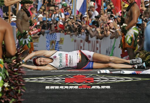 "Leanda Cave crossing the finish line in ""Blazeman"" style at Kona 2012"